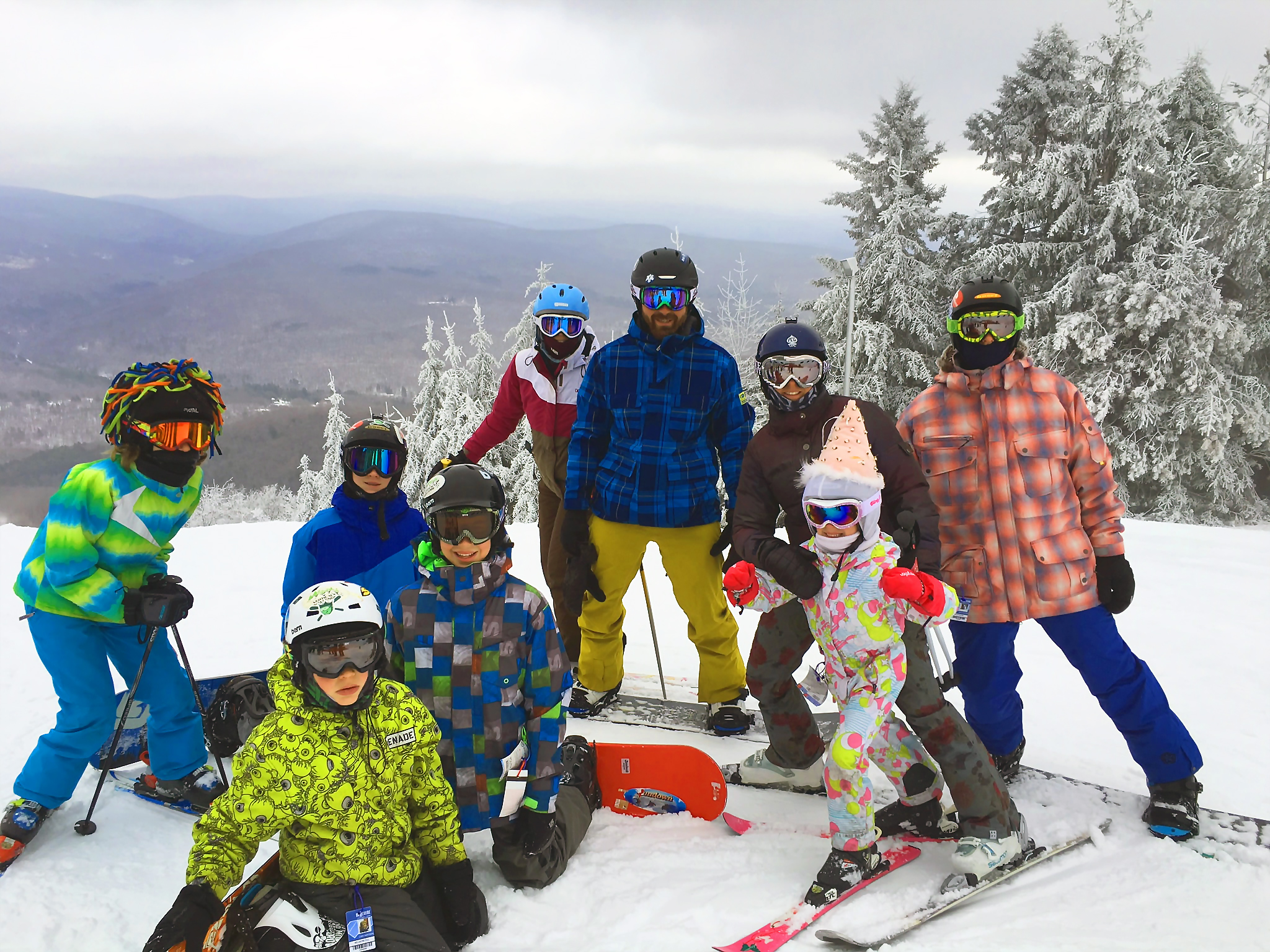family of skiers and riders